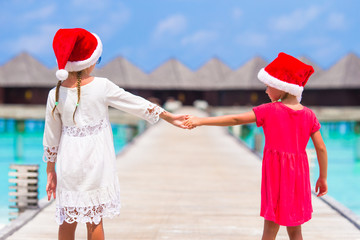 Little girls in red hats during Christmas vacation