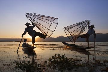 Intha fishermen at sunset, Inle Lake,  Myanmar