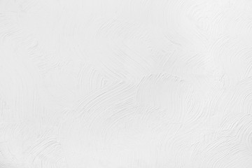 white wall with a pattern on the plaster. Texture, background