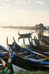 Boats on the Taungthaman Lake near Amarapura with the U Bein teak bridge behind, Mandalay, Myanmar (Burma), Southeast Asia