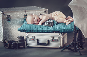 Portrait of a newborn little photographer