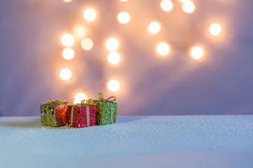 Lights come out from red, green, and golden gift boxes with pastel colors.
