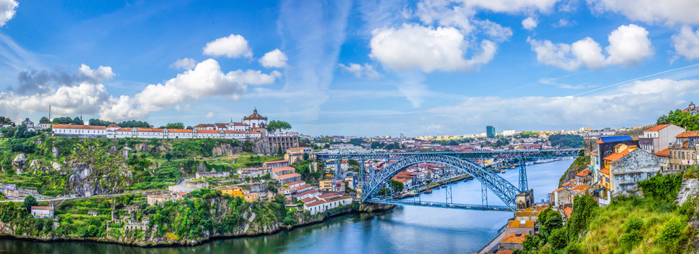 View of the historic city of Porto, Portugal with the Dom Luis bridge and blue sky / Panoramic view from the city of Porto in Portugal / Ancient city Porto,metallic Dom Luis bridge.