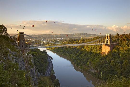 Clifton Suspension Bridge with hot air balloons in the Bristol Balloon Fiesta in August, Clifton, Bristol