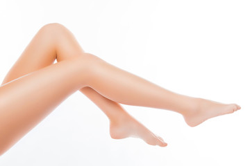 Close up photo of perfect smooth woman's legs on white backgroun