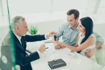 Real estate agent working with couple of customers and giving th
