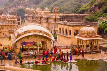 Women bathing in cistern, Jaipur, Rajasthan, India, Asia