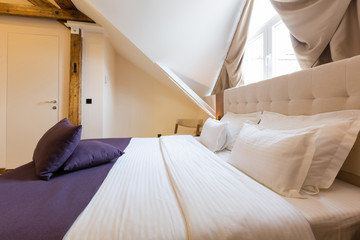 Hotel bedroom interior in the loft apartment