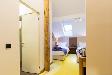 Interior of a hotel bedroom in the attic