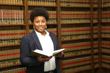Portrait of an attractive African American female lawyer in law library