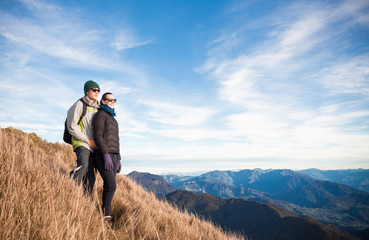 male and female hiker's on a mountain enjoying the view.