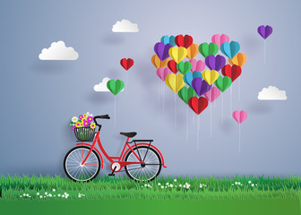 Red bikes parked on the grass with heart shaped balloons