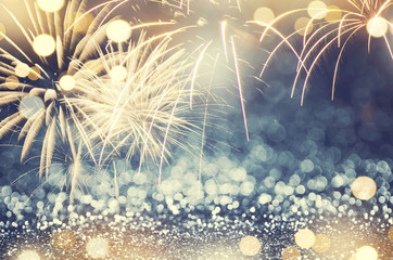 Fototapete - Gold and green Fireworks and bokeh in New Year eve and copy space. Abstract background holiday.