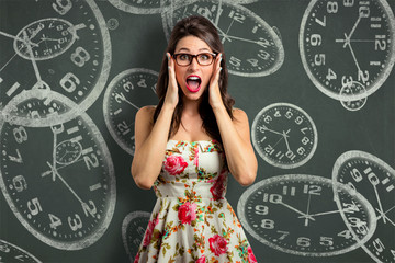 Woman overcome with stress, out of time management late anxious with clock background