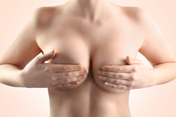 Woman breast, closeup. Plastic correction and surgery concept.