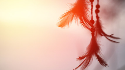 Dream catcher and the rising sun with blurred focus for background,