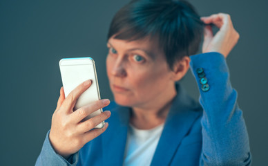 Business woman taking selfie portrait with mobile phone