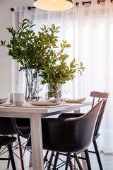 closed up nice dining chair with wooden table and dish sets inte