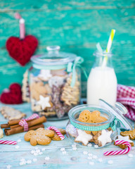 Homemade Christmas cookies in a jar on wooden rustic background.