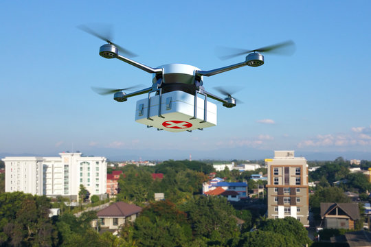 Drone with first aid kit flying over the town, Emergency medical care concept. 3D illustration