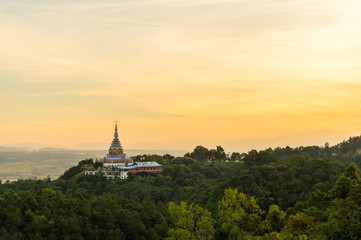 Tha Ton Temple set amid green mountains with sunset sky,Place for religious practices of Thailand