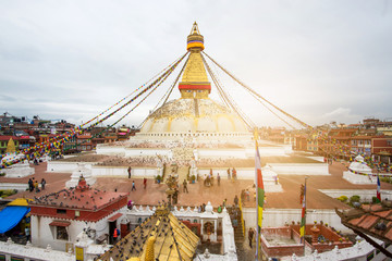 Buddha eyes close up with prayer flags at Bodhnath stupa in Kathmandu valley isolated on white, Nepal..
