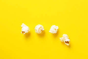 Popcorn on yellow and blue background. Top view. Contrast concept