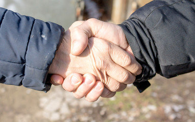 men shaking hands close-up