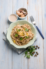spaghetti with tuna anchovies capers and lemon peel