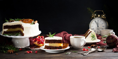 Piece of delicious chocolate cake with orange jam covered with cheese cream. Christmas dinner concept. Selective focus. Copy space.
