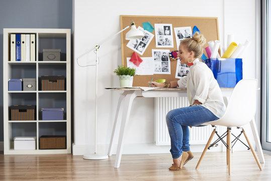 Fashionable woman creating at home interior