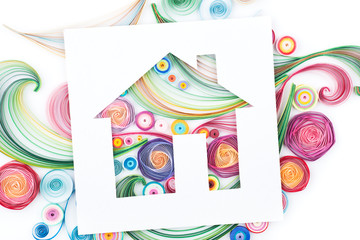 Concept of house on colorful paper made with quilling technique