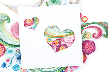 Concept of hearts on colorful paper made with quilling technique