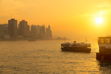 Star ferry passenger boats at sunset in victoria harbour, Hong kong