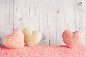 Valentine's hearts on a rustic background
