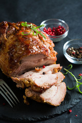 Baked ham with spices and herbs