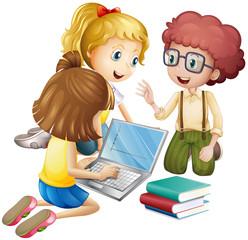 Three kids working on computer