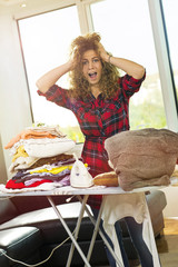 My clothes are ruined! Curly haired girl ironing.