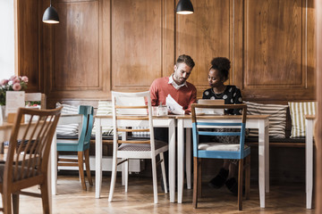 Young man and woman having a meeting in a cafe