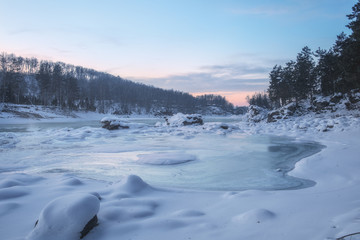 Frozen river/Frozen river and rocks covered with snow at sunset. Katun River, Mountain Altai, Siberia, Russia