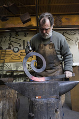 Blacksmith at work in his workshop