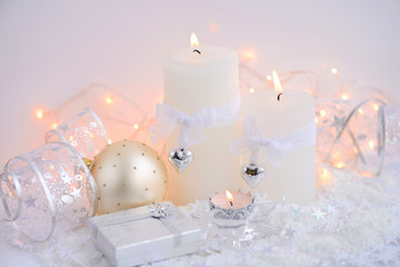 Christmas candles with Christmas baubles and Christmas lights. Festive Christmas background