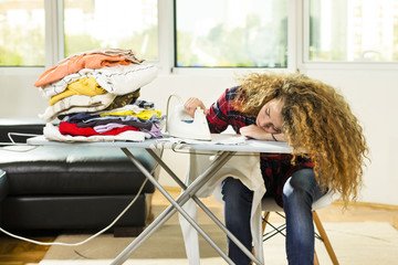 I am bored! A curly haired girl fell asleep while ironing.