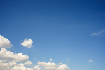 Blue sky and clouds in the lower left corner