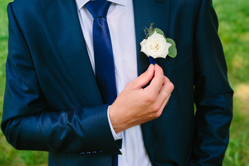 buttonhole on a blue suit groom