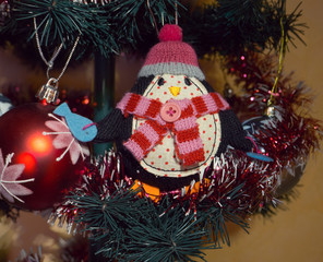 toy penguin on the Christmas tree . decoration