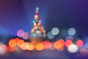 Blurred Christmas Background with Colorful Lighting and Shape of Christmas tree