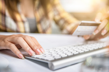 Woman shopping online Hands holding credit card and using laptop