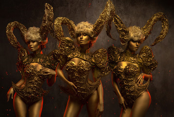 Beautiful devil women with golden ornamental horns on dark background