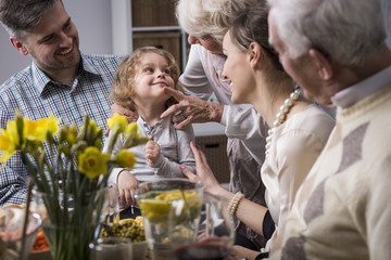 Three-generation family enjoying dinner